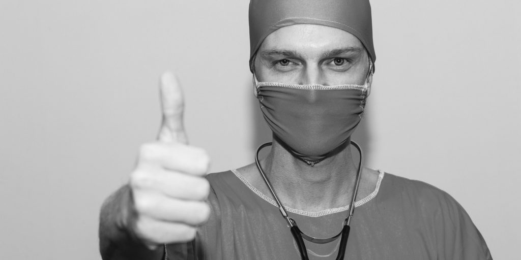 Doctor with one thumb up